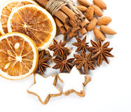 Cinnamon sticks, anise stars and cookies Royalty Free Stock Images