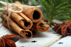 Cinnamon sticks and anise stars with decoration on wooden backgr Stock Photo
