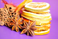 Cinnamon sticks, anise stars and dried oranges Stock Photography