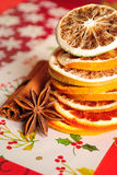 Cinnamon sticks, anise stars and dried oranges Stock Images