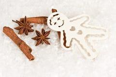 Cinnamon sticks anise stars and gingerbread man Royalty Free Stock Photos
