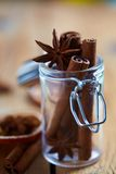 Cinnamon sticks and anise stars in glass jar Stock Photo