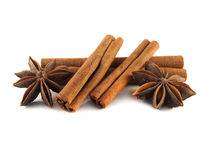 Cinnamon sticks and anise stars. Isolated. Cinnamon sticks and anise stars. Isolated on white background Stock Photos
