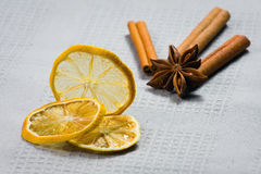 Cinnamon sticks, anise stars and sliced of dried citrus Stock Images