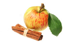 Cinnamon sticks and apple Royalty Free Stock Images