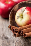 Cinnamon sticks and apples Royalty Free Stock Photo