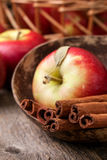 Cinnamon sticks and apples Royalty Free Stock Photos
