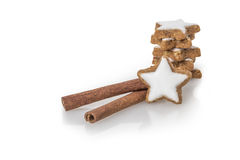 Cinnamon sticks with biscuit Stock Images