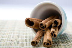 Cinnamon sticks in a blue cup. Royalty Free Stock Photo