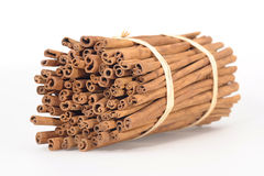 Cinnamon sticks bound together. Stack of group of cinnamon sticks all bound together, white studio background Royalty Free Stock Images