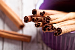 Cinnamon sticks in bowl Stock Photo