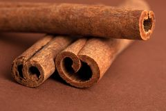 Cinnamon sticks on brown Stock Photography