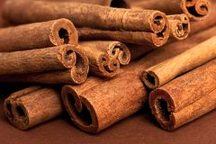 Cinnamon sticks on brown Stock Image