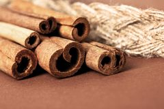 Cinnamon sticks on brown Royalty Free Stock Photography