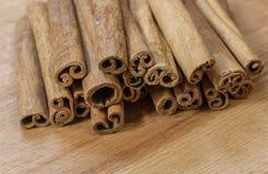 Cinnamon sticks. On brown board stock photo