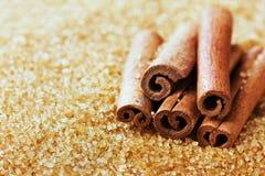 Cinnamon sticks on brown cane sugar Royalty Free Stock Photos