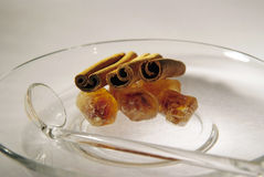 Cinnamon sticks and brown caramelized sugar. Cinnamon sticks, caramelized sugar and glass spoon on the glass dish, brown sugar crystal and spice Stock Photography