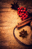 Cinnamon sticks,  Brown sugar and anise star on wooden table clo Royalty Free Stock Photo