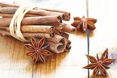Cinnamon sticks, brown sugar and anise stars Royalty Free Stock Photography