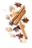 Cinnamon sticks, brown sugar, anise stars Stock Photos