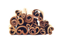 Cinnamon sticks. Brown cinnamon sticks on white isolated background Royalty Free Stock Images