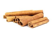 Cinnamon sticks. Brown cinnamon sticks on white isolated background Stock Photos