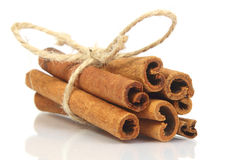 Cinnamon sticks bunch isolated on white background Stock Photos