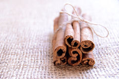 Cinnamon Sticks on Burlap Background Royalty Free Stock Photos