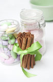 Cinnamon sticks and candy Royalty Free Stock Photo