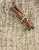 Cinnamon sticks canella on sack Royalty Free Stock Image