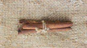 Cinnamon sticks canella on sack Royalty Free Stock Images