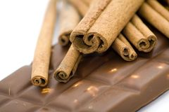 Cinnamon sticks and chocolate Royalty Free Stock Photo