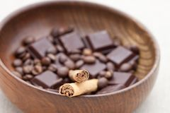 Cinnamon sticks with chocolate and coffee beans Royalty Free Stock Images