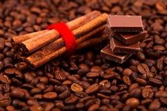 Cinnamon sticks with chocolate on coffee Royalty Free Stock Photography