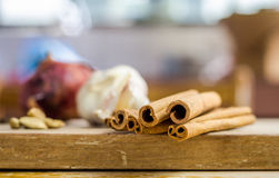 Cinnamon sticks on chopping board. Recent shot of Cinnamon sticks on chopping board royalty free stock photos