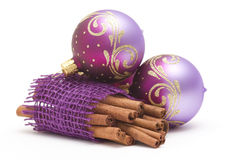 Cinnamon sticks and christmas balls Stock Photos