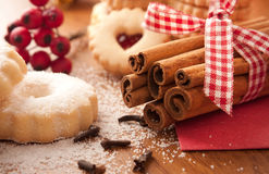Cinnamon sticks with Christmas cookies Royalty Free Stock Photos