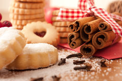 Cinnamon sticks with Christmas cookies Stock Images