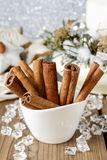 Cinnamon sticks in christmas setting Royalty Free Stock Images