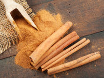 Cinnamon sticks and cinnamon powder in scoop Stock Image