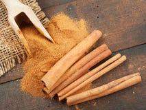 Cinnamon sticks and cinnamon powder in scoop Stock Image