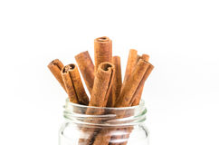 Cinnamon sticks. In glass isolated on white background Royalty Free Stock Images