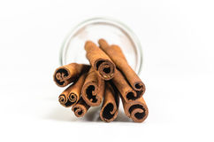 Cinnamon sticks. In glass isolated on white background Royalty Free Stock Photography
