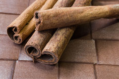 Cinnamon sticks close-up on brown background Royalty Free Stock Images