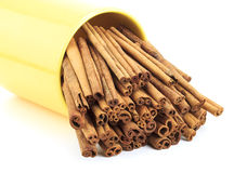 Cinnamon sticks close up. In a white background Stock Photos