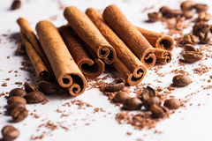 Cinnamon sticks, coffe beans and particles of chocolate Royalty Free Stock Images