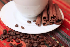 Cinnamon sticks with coffee Royalty Free Stock Image