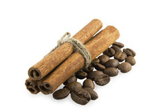 Cinnamon sticks and coffee beans. Cinnamon sticks to the left on coffee beans Royalty Free Stock Image