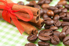 Cinnamon sticks and coffee beans Royalty Free Stock Photo
