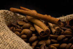 Cinnamon sticks and coffee beans Stock Photos